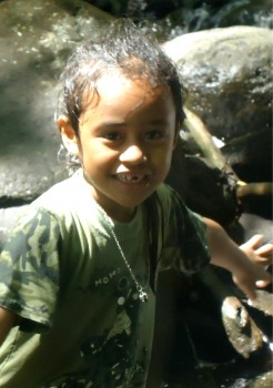 Samoan child with a lovely smile snapped at my favourite location in Samoa.